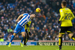 Shane Duffy of Brighton & Hove Albion heads the ball under pressure from Lucas Akins of Burton Albion - Mandatory by-line: Jason Brown/JMP - 11/02/2017 - FOOTBALL - Amex Stadium - Brighton, England - Brighton and Hove Albion v Burton Albion - Sky Bet Championship
