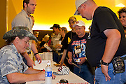 16 MAY 2009 -- PHOENIX, AZ: Rocker and gun owner rights advocate TED NUGENT signs autographs at the NRA convention in Phoenix Saturday. About 60,000 people were expected to attend the trade show at the 138th annual National Rifle Association Annual Meeting in the Phoenix Convention Center in Phoenix, AZ. Photo by Jack Kurtz
