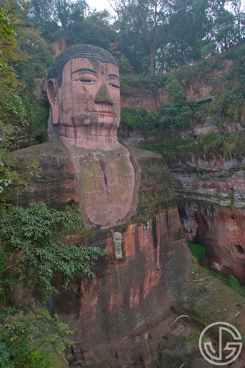 The Leshan Giant Buddha was built during the Tang Dynasty (618-907) and is said to be the largest carved stone Buddha in the world.. It is carved out of a cliff face that lies at the confluence of the Minjiang, Dadu and Qingyi rivers in the southern part of Sichuan province in China, near the city of Leshan. (photo by Joe Gosen © 2006)