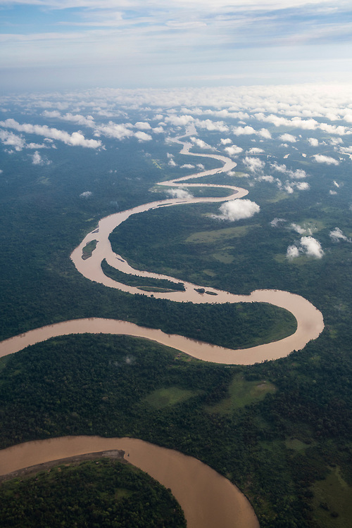 Aerial view of the Ramu River, one of the primary rivers in Papua New Guinea. The disused grass airstrip at Chungribu is visible in the upper part of the photo, to the left of the river.<br />(June 20, 2019)