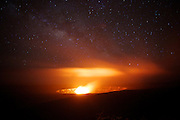 Nighttime view of Halemaumau Crater in the Kilauea caldera, with the Milky Way visible in the background. Steam from the crater is lit up by lava. Kilauea is located in Hawaii Volcanoes National Park, on the Big Island of Hawaii.