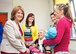 Joan Burton TD, Minister for Social Protection officially opened the Phibblestown Community Campus in Clonee today (Friday 26th April).. .Pictured a opened the Phibblestown Community Campus in Clonee today (Friday 26th April)...Joan Burton TD, Minister for Social Protection..Nelli Gallagher,.Sabrina Carpenter,.Shannon Cahill.Julie Gill...The Phibblestown campus is a new educational model which consists of the community primary school - Scoil Ghrainne, post primary school - Colaiste Pobail Setanta and Phibblestown Community Centre co-located on one campus.. .Minister Burton remarked: I am delighted to be invited here today to see this unique community project at first hand and the fruits of the combined efforts of so many local people. The facility is supported by my Department through participants in the TUS programme who will soon be joined by participants in the JobBridge Internship Scheme and Community Employment Programme. This is indeed an appropriate way for communities to avail of these worthy schemes.. .Scoil Grainne CNS and Pobalscoil Setanta are under the Patronage of County Dublin VEC and are located on a shared campus in Phibblestown.. .The accommodation on the Phibblestown campus includes:. .A new 24 classroom Primary School including Special Needs Unit.A new 1000 pupil Post-primary school including Special Needs Unit.A shared Community Facility including an All Weather Pitch under the auspices of Fingal County Council.. .The new primary school was occupied in August 2010 and the post-primary school in November 2010. The all-weather pitch and ball-courts were handed over in March 2011 and the overall project was substantially completed in November 2011.. .ENDS