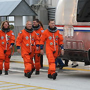 The space shuttle Atlantis astronauts left to right, Sandy Magnus, pilot Doug Hurley, mission specialists Rex Walheim, and commander Chris Ferguson wave after leaving the operations and check-out building on their way to the pad at the Kennedy Space Center Friday, July 8, 2011, in Cape Canaveral, Fla. Shuttle Atlantis is scheduled to launch on Friday, July 8 and is the 135th and final space shuttle launch for NASA..  (AP Photo/Alex Menendez)