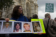Sexual abuse victims stand outside Westminster Abbey to show pictures of themselves as young people during Pope Benedict XVI's papal tour of Britain 2010, the first visit by a pontiff since 1982. Taxpayers footed the £10m bill for non-religious elements, which largely angered a nation still reeling from the financial crisis. Pope Benedict XVI is the head of the biggest Christian denomination in the world, some one billion Roman Catholics, or one in six people. In Britain there are about five million Catholics but only a quarter of Catholics regularly attend Sunday Mass and some churches have closed owing to spending cuts.