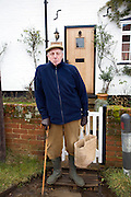 Senior man portrait wearing flat cap hat and warm jacket - no Model Release
