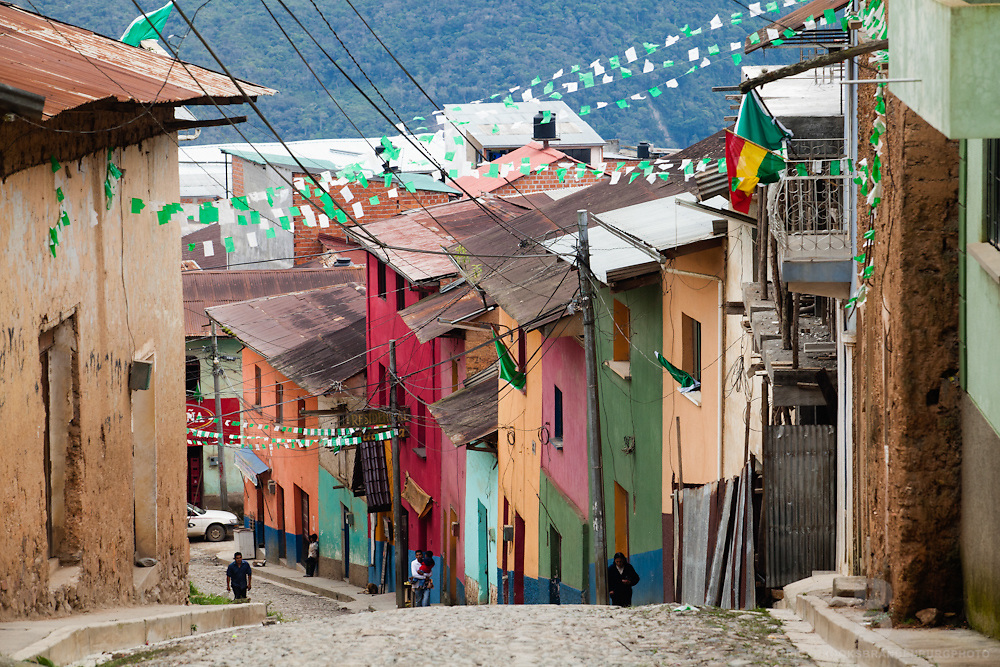A look down a colorful coblestone street in the small town of Coroico, Bolivia.