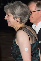 © Licensed to London News Pictures. 13/11/2017. London, UK. British Prime Minister THERESA MAY arrives for the annual Lord Mayor's Banquet at Guildhall. The Prime Minister was wearing a glucose monitor on her left arm.  Photo credit: Ray Tang/LNP