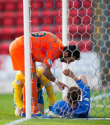 Kilmarock's Manuel Pascali annoyed at St Johnstone's Murray Davidson after his challenge on the keeper.<br /> St Johnstone 1 v 2 Kilmarock, SPL game played at McDrarmid Park.