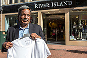 Amirul Haque Amir, President of Bangladeshi Federation of Garment Workers, outside River Island in Bournemouth, Dorset, United Kingdom.