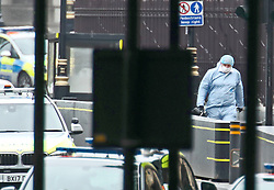 A forensic officer attends the scene near the Houses of Parliament, Westminster in central London, after a car crashed into security barriers outside the Houses of Parliament.