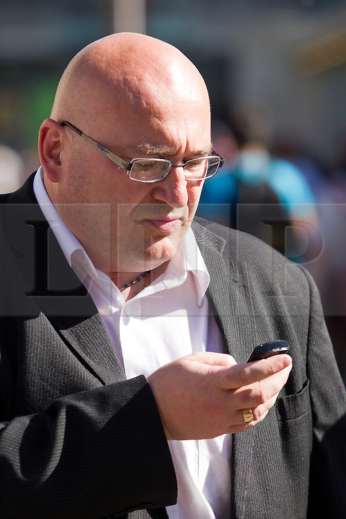 "© Licensed to London News Pictures . FILE PICTURE DATED 08/09/2012 .  Manchester , UK . DOMENYK NOONAN (pictured in Manchester City Centre on 8th September) has been remanded in custody . He is accused of raping a 15 year old boy . He appeared at Manchester Crown Court via videolink from Manchester prison , charged with four counts of rape and false imprisonment . Police were called to a flat in Manchester City Centre on the afternoon of Wednesday (24th October) . The organised crime boss and star of documentary ""At Home With the Noonans"" also goes under the name Lattlay-Fottfoy .  He is a cousin of Mark Duggan , whose shooting sparked off riots in London in the summer of 2011 . Photo credit : Joel Goodman/LNP."