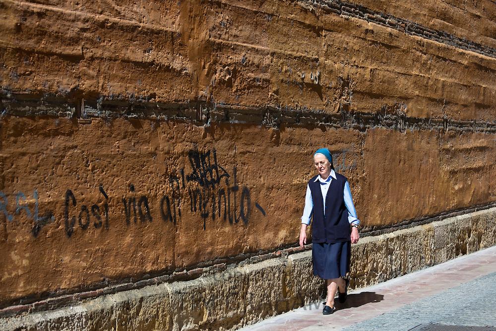 Spanish religious nun wearing nun's habit in Calle Sacramento in Leon, Castilla y Leon, Spain