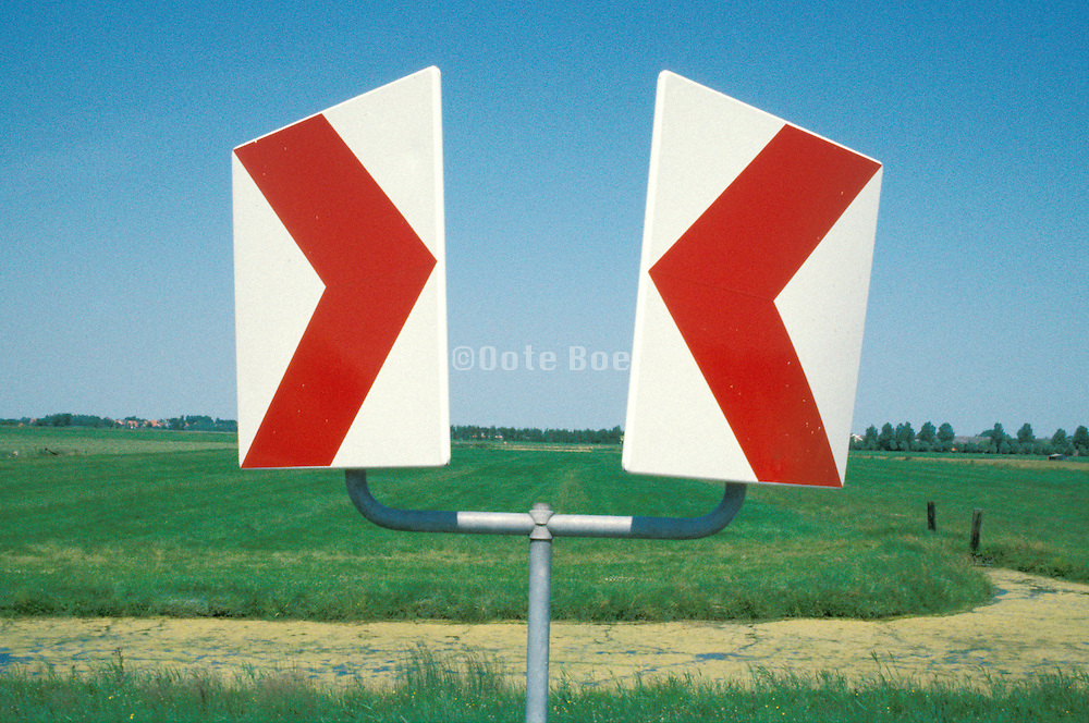 directional symbols amidst grassy field Holland