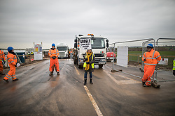 © Licensed to London News Pictures . 10/03/2017 . Preston , UK . An anti fracking protester stands in the path of a departing lorry at the entrance to the fracking site on Plumpton Hall Farm . Farmer Allan Wendlsy faces protests from neighbours and environmental campaigners after renting fields around his farm , Plumpton Hall Farm , to fracking firm Cuadrilla . Photo credit : Joel Goodman/LNP