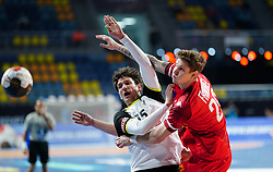 14.01.2021, 6th of October Sports Hall, Gizeh, EGY, IHF WM 2021, Österreich vs Schweiz, Herren, Gruppe E, im Bild Nikola Stevanovic, Andy Schmid, Thomas Eichberger, // during the IHF men's World Championship group E match between Austria and Switzerland at the 6th of October Sports Hall in Gizeh, Egypt on 2021/01/14. EXPA Pictures © 2020, PhotoCredit: EXPA/ Diener/Eva Manhart<br /> <br /> *****ATTENTION - OUT of AUT and SUI*****