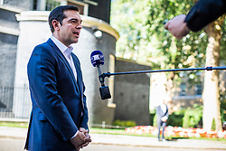 © Licensed to London News Pictures. 26/06/2018. London, UK. Prime Minister of Greece Alexis Tsipras speaks to the press outside 10 Downing Street after meeting with Prime Minister Theresa May. Photo credit: Rob Pinney/LNP