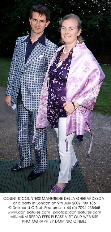 COUNT & COUNTESS MANFREDIE DELLA GHERARDESCA at a party in London on 9th July 2002.	PBX 186