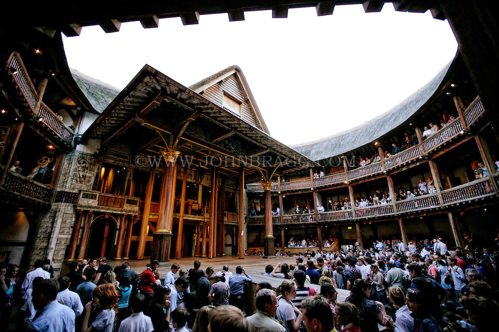 The stage and galleries inside The Shakespeare Globe Theatre, London, England.