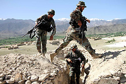 April 14, 2017 - Nangarhar, Afghanistan - An Afghan army soldiers walk near a checkpoint, 2 km from the explosion core area in Achin district of eastern Nangarhar province. At least 36 Islamic State (IS) militants were killed after the U.S. forces in Afghanistan struck their position with a large bomb in eastern Nangarhar province, the Afghan Defense Ministry said on Friday morning.   (Credit Image: © Rahman Safi/Xinhua via ZUMA Wire)