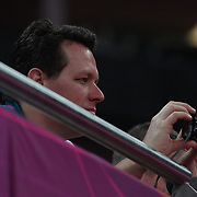 Kieran Perkins photographing Joshua Jefferis, Australia, in action during the Men's Artistic Gymnastics podium training at North Greenwich Arena during the London 2012 Olympic games preparation at the London Olympics. London, UK. 25th July 2012. Photo Tim Clayton