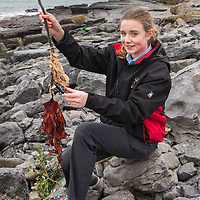 Jessica Kelly from Mary Immaculate Secondary School, Lisdoonvarna, with some Himanthalia elongata found at different locations in North Clare