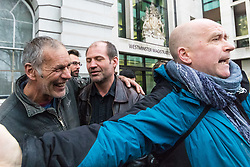 James Matthews (centre), 43, is greeted by supporters as he arrives at Westminster Magistrates Court where he faces a charge of attending a place used for terrorist training, under the Terrorism Act 2006, after fighting against ISIS with the Kurdish YPG militia. London, February 14 2018.