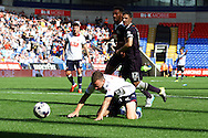 Jay Spearing of Bolton Wanderers breaks clear but takes a tumble. Skybet football league championship match, Bolton Wanderers v Derby County at the Macron stadium in Bolton, Lancs on Saturday 8th August 2015.<br /> pic by Chris Stading, Andrew Orchard sports photography.