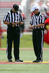 15 September 2012:  Umpire Brad Hudak and Referee Kerry Ripley during an NCAA football game between the Eastern Illinois Panthers and the Illinois State Redbirds at Hancock Stadium in Normal IL