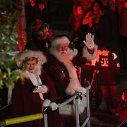Santa and Mrs. Claus wave during the 12th Annual Wilmington Holiday Parade Sunday December 7, 2014 in Wilmington, N.C. (Jason A. Frizzelle)