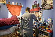 An 'Enhanced' prisoner in his room on H wing at the Young Offenders Institution  in Aylesbury, United Kingdom.  Under the Incentives and Earned Privilege Scheme, prisoners in the U.K. can earn extra privileges for good behaviour such as wearing their own clothes, having televisions in their cells, and having more free time to socialise.  They are often housed together in their own wing.  There are three levels of earned privileges - Basic, Standard and Enhanced.