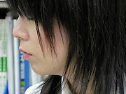 side view of a young adult Japanese female office worker