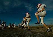 11/7/07 Smith Center, KS.Smith Center High School football team warms up during practice..(Chris Machian/for the New York Times)..(Chris Machian/for the Prairie Pixel Group).(Chris Machian/Prairie Pixel Group)