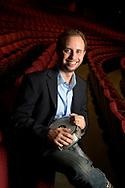 Orlando Philharmonic Orchestra percussionist John Patton poses in the Bob Carr Auditorium in Orlando, Fla., Friday, Nov. 27, 2015. (Phelan M. Ebenhack via AP)