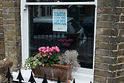 A poster in support of a pay rise for NHS workers is pictured in the window of house on 2nd July 2021 in Windsor, United Kingdom. It has been announced that senior doctors in England may refuse to work overtime if the government does not improve upon their current 1% pay increase offer.