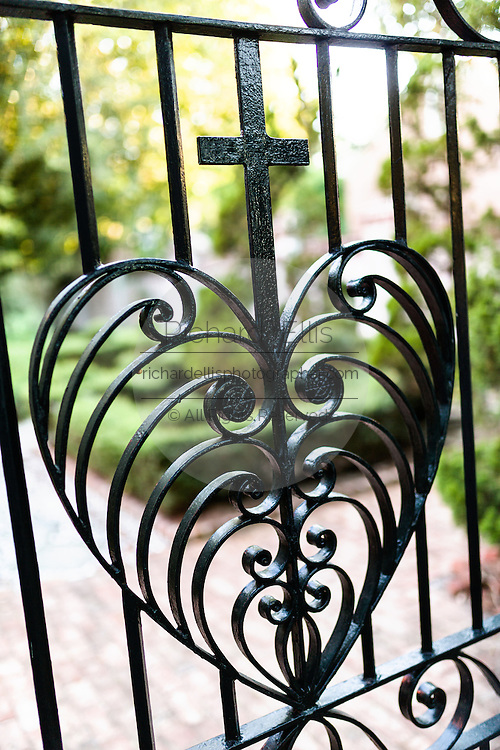 The Double Heart gate at the entrance to Philip Simmons Park at St John's Reformed Episcopal Church by blacksmith Philip Simmons in historic Charleston, SC.