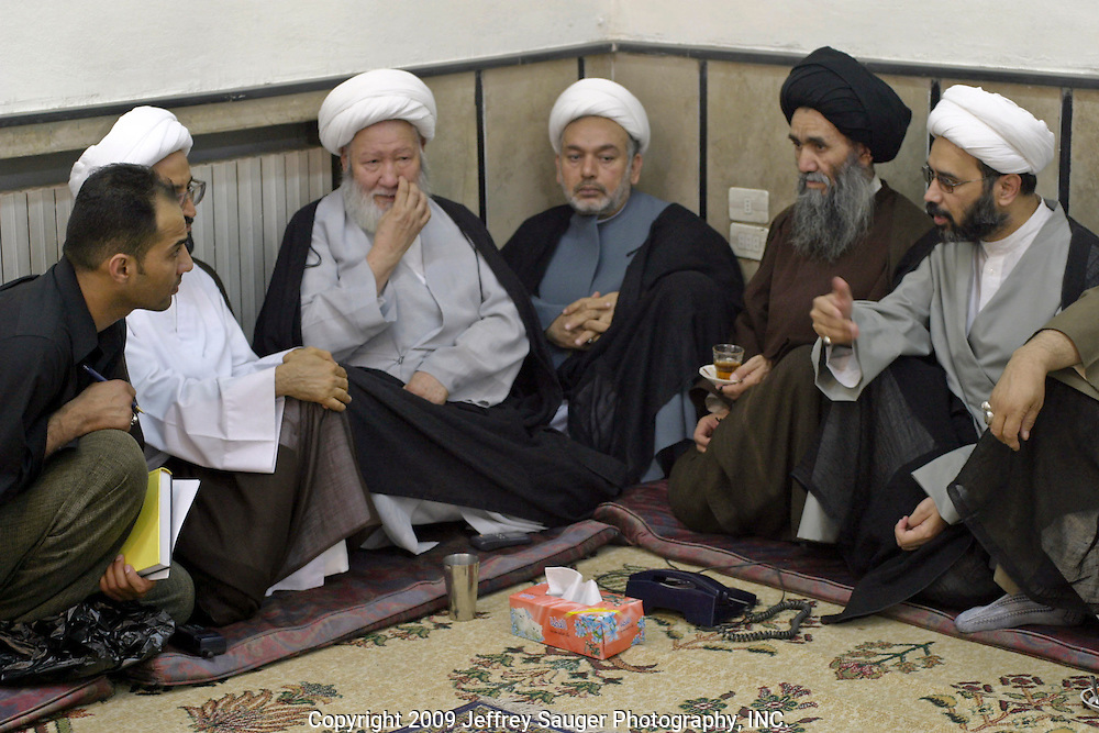 Emad Al-kasid, far left, meets with Shiite religious leaders as the men gather before prayer at the Howza of Ayotollah Shirazi the Iraqi area of Damascus, Syria, Wednesday, July 16, 2003. The men in white Amima, head covering, are sheiks and the man in black is a said. Sheiks are regular men who are educated in religious teachings while a said can trave his lineage to Prophet Mohammad. A Howza is like a seminary where men come to study. In this Shiite Howza, the philosophy of Ayotollah Shirazi is taught. As with all Shiite, advocacy of non-violence is the pre-eminent rule. Hundreds of thousands of Iraqi Shiite settled in Syria after the Gulf War and their uprising against Saddam Hussein in 1991.