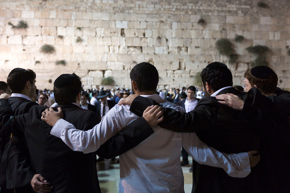 Jewish men participate in Selichot, Hebrew for forgiveness, a prayer in which Jews offer repentance and ask God to forgive their sins, ahead of the Jewish holiday of Yom Kippur, the Day of Atonement, at the Western Wall, Judaism's holiest prayer site in Jerusalem's Old City on October 2, 2014. Yom Kippur which starts at sundown Friday, is the holiest of Jewish holidays, when observant Jews atone for the sins of the past year, refrain from eating and drinking and attend intense prayer services in synagogues.