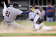 CHICAGO - JUNE 09:  Scott Podsednik #22 of the Chicago White Sox slides safely into home on a wild pitch as pitcher Dontrelle Willis #21 of the Detroit Tigers is late with the tag on June 9, 2009 at U.S. Cellular Field in Chicago, Illinois.  (Photo by Ron Vesely)