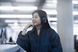 Businesswoman listening to music with headphones, Freiburg im Breisgau, Baden-W¸rttemberg, Germany