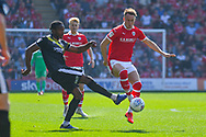 Cauley Woodrow of Barnsley (9) and Omar Beckles of Shrewsbury Town (6) in action during the EFL Sky Bet League 1 match between Barnsley and Shrewsbury Town at Oakwell, Barnsley, England on 19 April 2019.