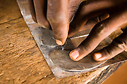A man making statuettes from recycled metal at the Village Artisanal de Ouagadougou, a cooperative that employs dozens of artisans who work in different mediums, in Ouagadougou, Burkina Faso, on Monday November 3, 2008.