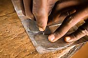 A man making statuettes from recycled metal at the Village Artisanal de Ouagadougou, a cooperative that employs dozens of artisans who work in different mediums, in Ouagadougou, Burkina Faso, on Monday November 3, 2008.