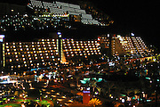 The big hotel complexes at night time in Puerto Rico bay, Gran Canaria, Canary Islands. Spain.