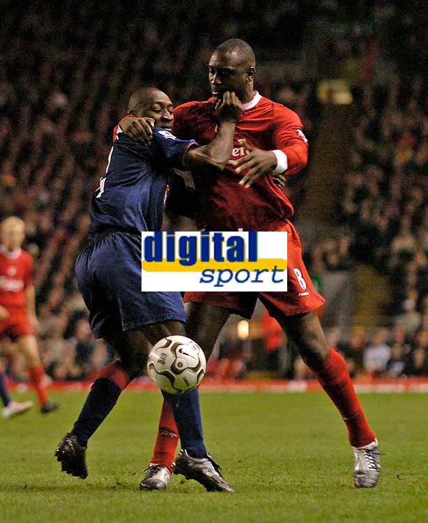 Photo. Jed Wee.Digitalsport<br /> Liverpool v Portsmouth, FA Barclaycard Premiership, Anfield, Liverpool. 17/03/2004.<br /> Liverpool's Emile Heskey (R) gets close to Portsmouth's Lomana Lua Lua.