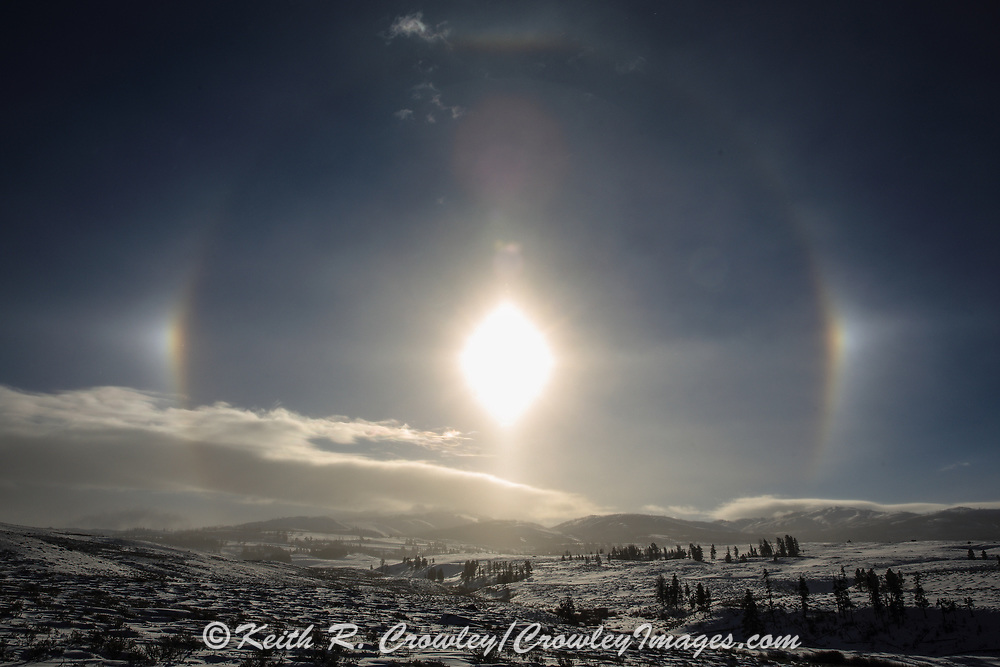 Sundogs, formed by ice crystal in sub-zero air, form around the sun over the Blacktail Plateau in Yellowstone National Park.