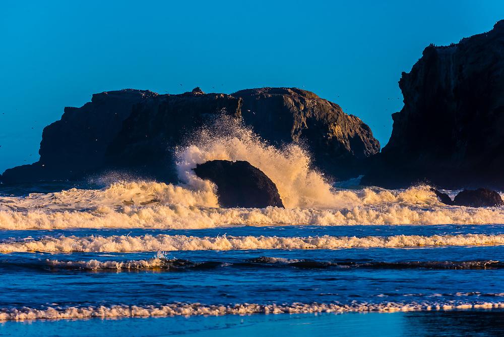 Waves pounding rock formations off Bandon Beach, Oregon USA.
