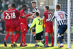 18 February 2017 - FA Cup, Fifth Round - Millwall v Leicester City<br /> Jake Cooper of Millwall gets into an argument with Leicester goalkeeper Ron Robert Zieler<br /> Photo: Charlotte Wilson