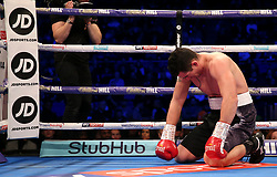 Morgan Dessaux on the floor during the heavyweight contest at The O2 Arena, London.