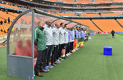 South Africa: Johannesburg: Bafana Bafana coach Stuart Baxter sing the national anthem along side his technical team during the Africa Cup Of Nations qualifiers against Seychelles at FNB stadium, Gauteng.<br /> Picture: Itumeleng English/African News Agency (ANA)