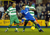 Fotball<br /> England 2004/2005<br /> Foto: SBI/Digitalsport<br /> NORWAY ONLY<br /> <br /> Millwall v Queens Park Rangers<br /> Coca Cola Championship. <br /> 05/02/2005<br /> <br /> Scott Dobie of Millwall tries to get clear of Richard Edghill and Dan Shittu of QPR